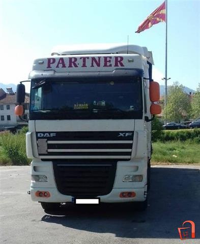 Kamion-vlekac-so-polu-prikolka-vo-odlicna-sostojba